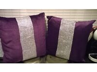 Two purple cushions