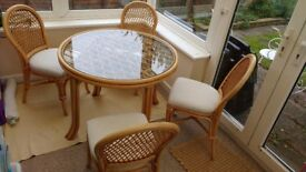 Beautiful cane / wicker dining table and 4 matching chairs