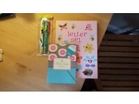 Stationary - Letter set, sticky lables and pens.