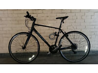 Giant Escape sports bike. Black and grey. Great condition. Less than a year old and barely used.
