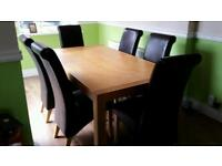 Solid oak table 6ft by 3ft 3inch & 6 roll back brown leather chairs