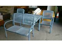 Aluminium garden set. Featuring table, 4 chairs and bench seat