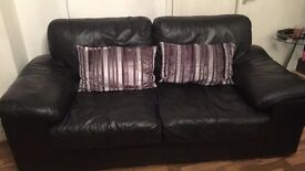 Real Leather Sofas with cushions and rug