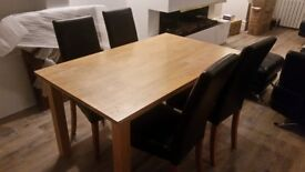 Beautiful wooden dining table and 4 faux leather chairs