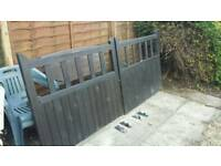 Black stained wooden drive way gates