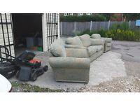 2 seater sofa and 2 arm chairs in pale green.