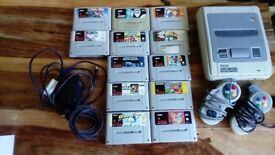 Super nintendo with 2 controllers and 12 games