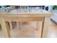 Oak extending table simple flip top design. .