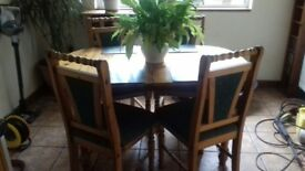 Pine extending table and 4 chairs.