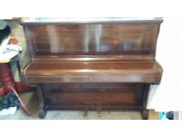 An upright piono for FREE