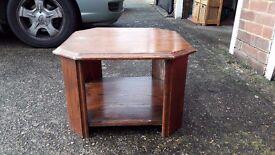 Hexagonal dark wooden coffee table