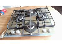 Hob from hotpoint. Quality used but in very good condition. Chrome with cast iron racks