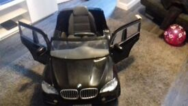 bmw x5 black toy electric ride on. cones with no charger but is in excellent condition