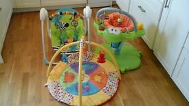 Three baby items, battery rocker, floor mat and bouncing frog