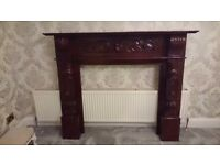Large ornate fire surround.