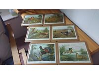 Six gold edged placemats depicting Game Birds and two Staffs Teaset Co Ltd saucers