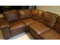 Corner sofa in light brown leather , available for immediate collection. Good condition,little wear