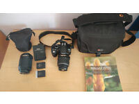 Nikon D3100 with kit 18-55mm and 55-200mm lens