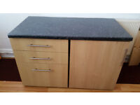 2 cabinets with black glossy worktop
