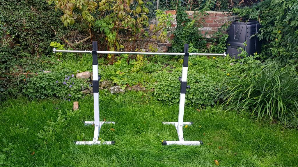 Heavy duty adjustable squat rack stand. Plus bench support. Includes 6 foot bar.