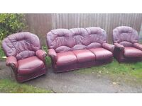 Cute 3 piece cherry red leather sofa suite. 3 seater sofa and 2 armchairs.well used. can deliver