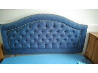 Blue padded headboard for double bed