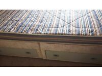 Double bed with mattress drawers in base