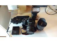 Canon 550D Digital SLR + 2 lenses + external flash