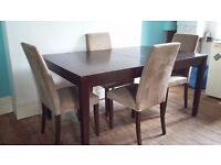 Real dark wood table (seats up to 8), 4 chairs and matching sideboard.