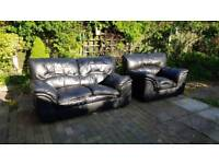 Black leather two seater sofa with arm chair
