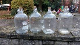 4 demijohn glass jars £20