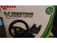 Brand new steering wheel and pedals. Suitable ps2 ps3 xbox etc