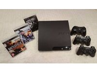Sony PlayStation 3 (PS3) Slim 160GB with 3 Controllers and 3 Great Games