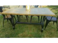 Lovely wood dining table with black ornate base