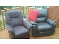 two manual recliner leather chairs