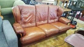 3 Seat Reddish Tan Sofa With Wooden Frame In Good Condition