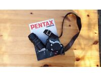 Pentax MG camera with 50mm lens and 70-150 zoom