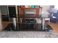 Stunning solid black glass tv stand