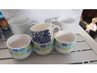A job lot of mugs cups and beakers