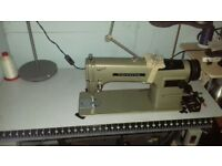 Industrial flat bed sewing machine