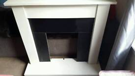 White fireplace and hearth