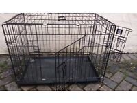 medium size dog crate with two openings and tray