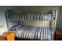 Metal single bunk beds with mattresses