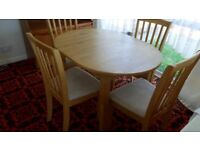 extending oval dining table & 4 padded chairs