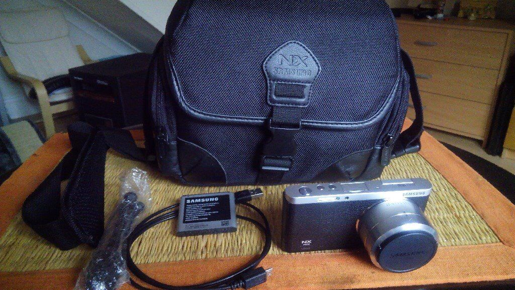 Samsung NX mini black with 9-27 lens, extra battery, cable,tripod and Samsung NX shoulder bag