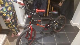 Boys Bmx bike..... frame in excellent condition, seat has a tear in .