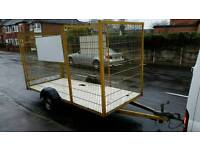 Caged trailer with brakes