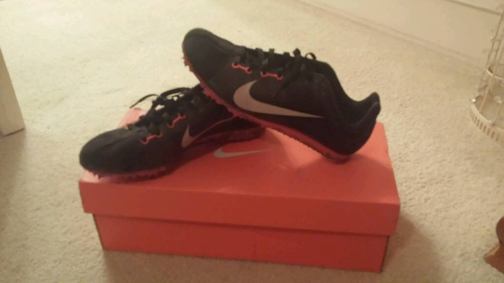 Nike running shoes sized 3 4 with spikesin Southampton, HampshireGumtree - Small Nike running shoes with spikes. Size 3 4 in black and orange. Have been worn but good condition