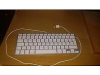 Mac keyboard for sale. Has two usb on both sides. Rarely used