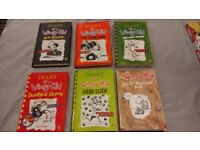 5 Tom Gates books and 5 Diary of a wimpy kid books